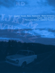 The white car.  Original photography by Dan Armstrong.  Booklet art by Robin Armstrong.