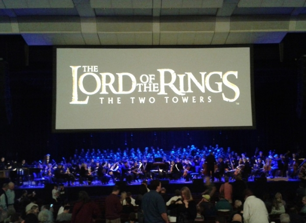 Image result for orchestra playing to movie screen
