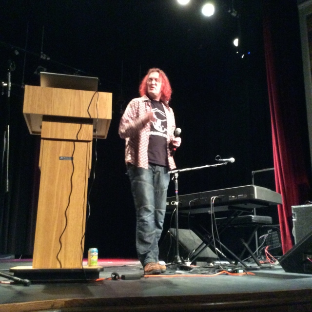 Tillison, lecturing on the transformation of the protest song in a world of Facebook and Twitter.
