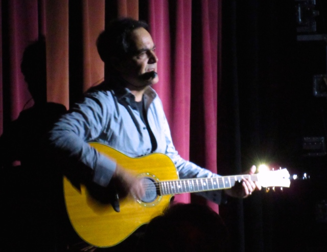 "Neal, in a quiet acoustic moment, singing ""Somber Days"" from TESTIMONY."