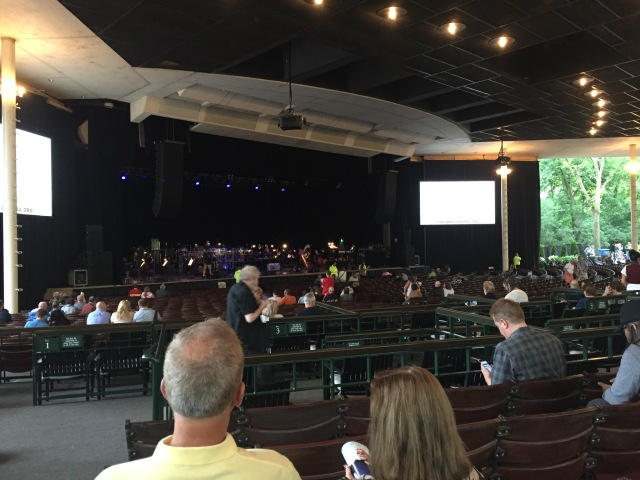 Landscape view of the Ravinia pavilion and stage from the back left of the pavilion.
